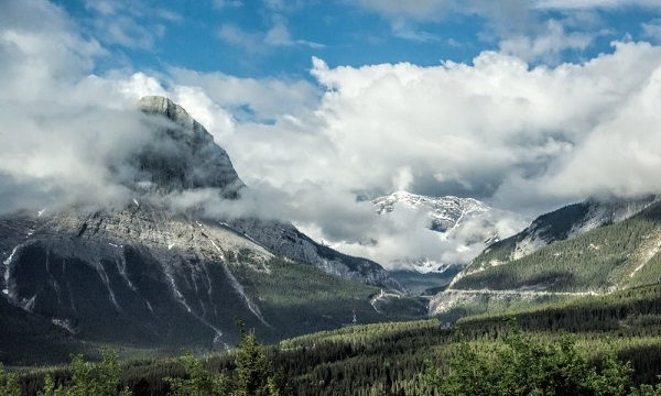 Photo Credit http://www.theuntappedsource.com/artwork/clouds-and-mist-over-canadian-rocky-mountain-peaks-by-gerda-grice/40804/