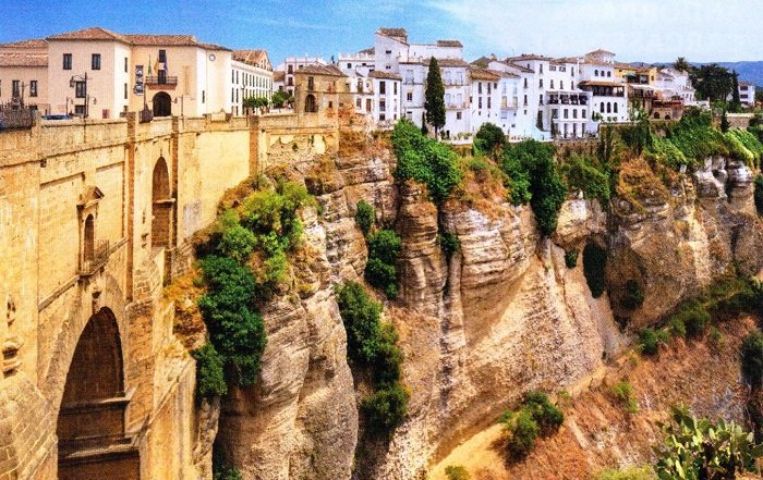 Photo Credit  https://apetcher.wordpress.com/2013/04/01/alternative-twelve-treasures-of-spain-ronda-puente-nuevo-and-bullfighting/