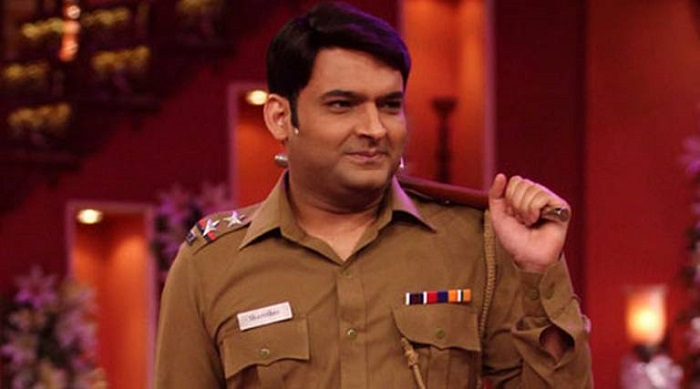 Photo Credit http://www.abplive.in/tv/2014/10/07/article415360.ece/Kapil-Sharma-bagged-role-in-RGV%E2%80%99s-ne