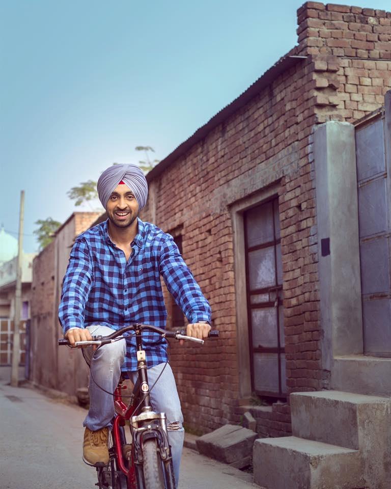 Diljit-Dosanjh-Riding-Bicycle